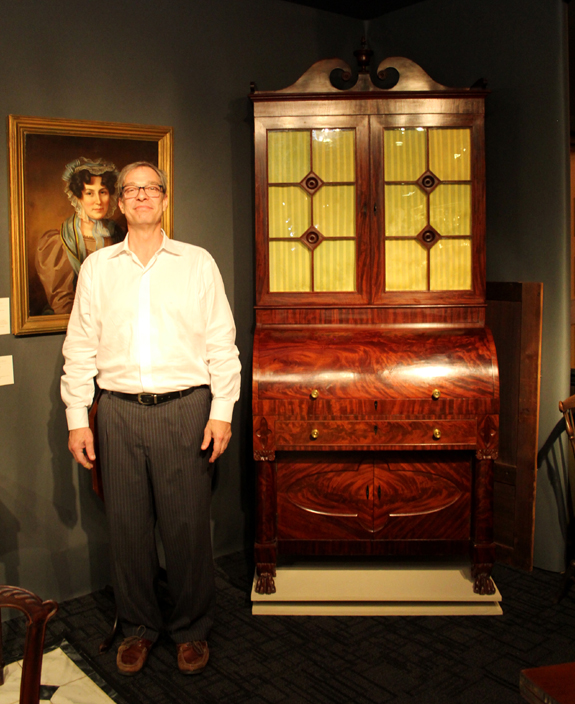 North Wales, Penn., dealer Christopher T. Rebollo created a revolving stand for displaying both sides of this beautifully crafted 1825–30 Baltimore cylinder desk by John Needles.