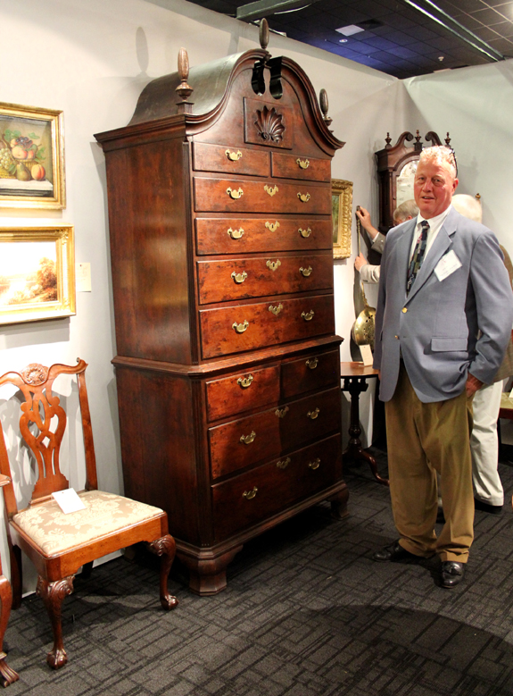 John Welch of H.L. Chalfant Antiques, West Chester, Penn., with a Philadelphia Chippendale bonnet-top chest on chest, signed George Claypoole, circa 1755.