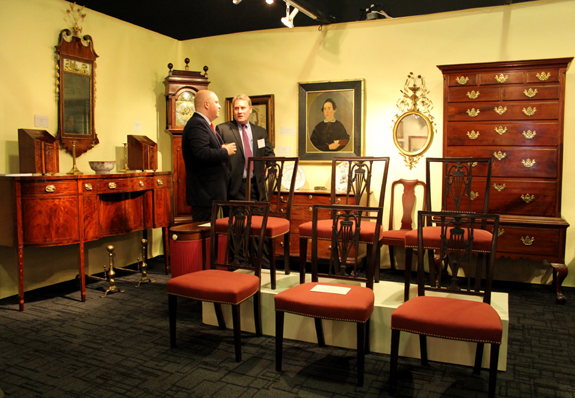 Adam Erby, associate curator at George Washington's Mount Vernon, and Frank Levy, right, in the booth of Bernard & S. Dean Levy Antiques, New York City.