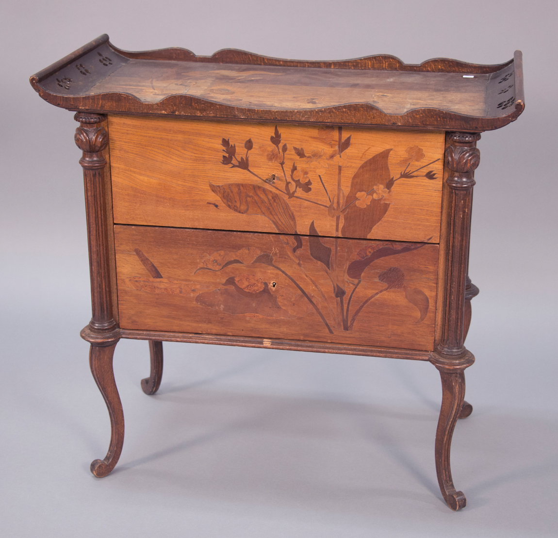 Art Nouveau cabinet with floral inlays, signed Galle,<br>height 30 inches, $ 5,000 ($ 2/4,000).