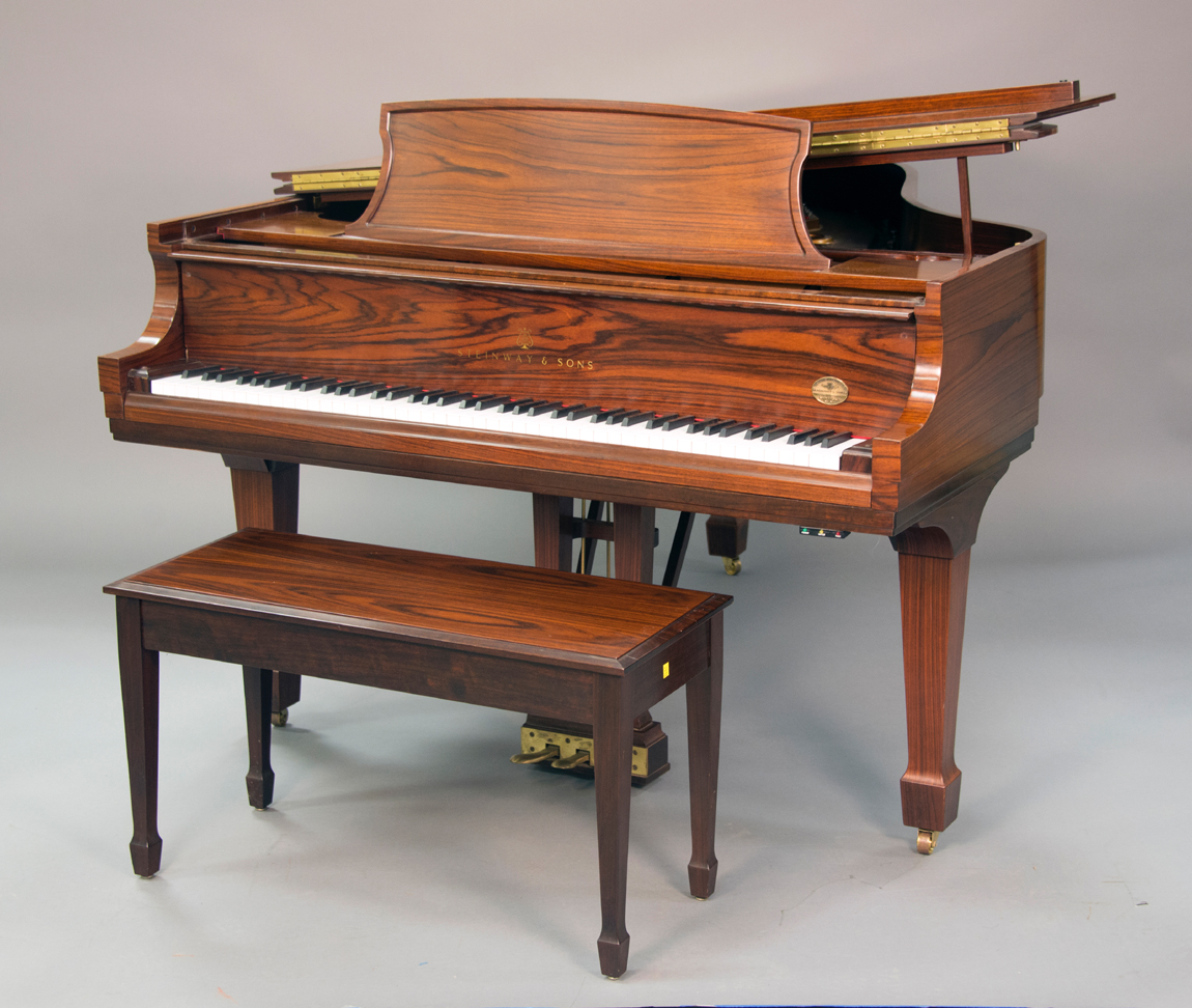 "Grand piano in an East Indian rosewood case, from Steinway &amp; Son's<br>""Crown Jewel"" collection, $ 24,000 ($ 15/25,000)."