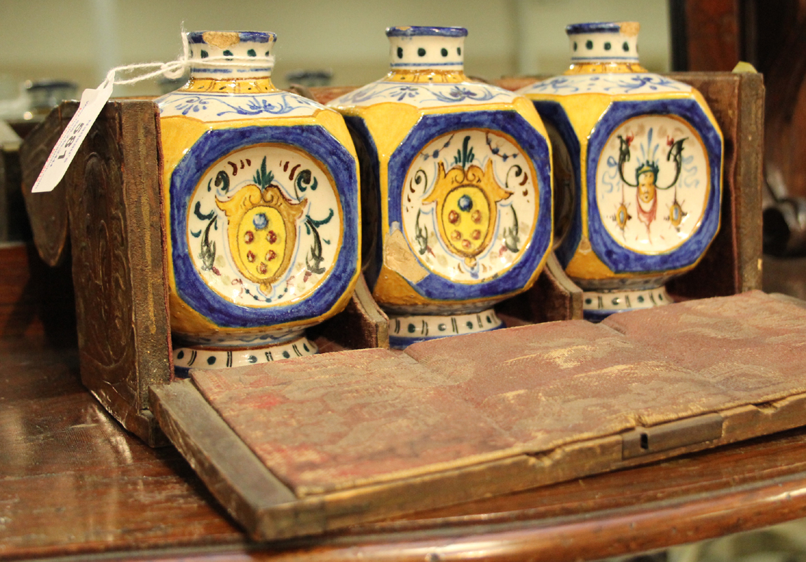 These three majolica polychrome bottles, $ 420, in fitted box were cataloged as Nineteenth Century Italian or Portuguese.