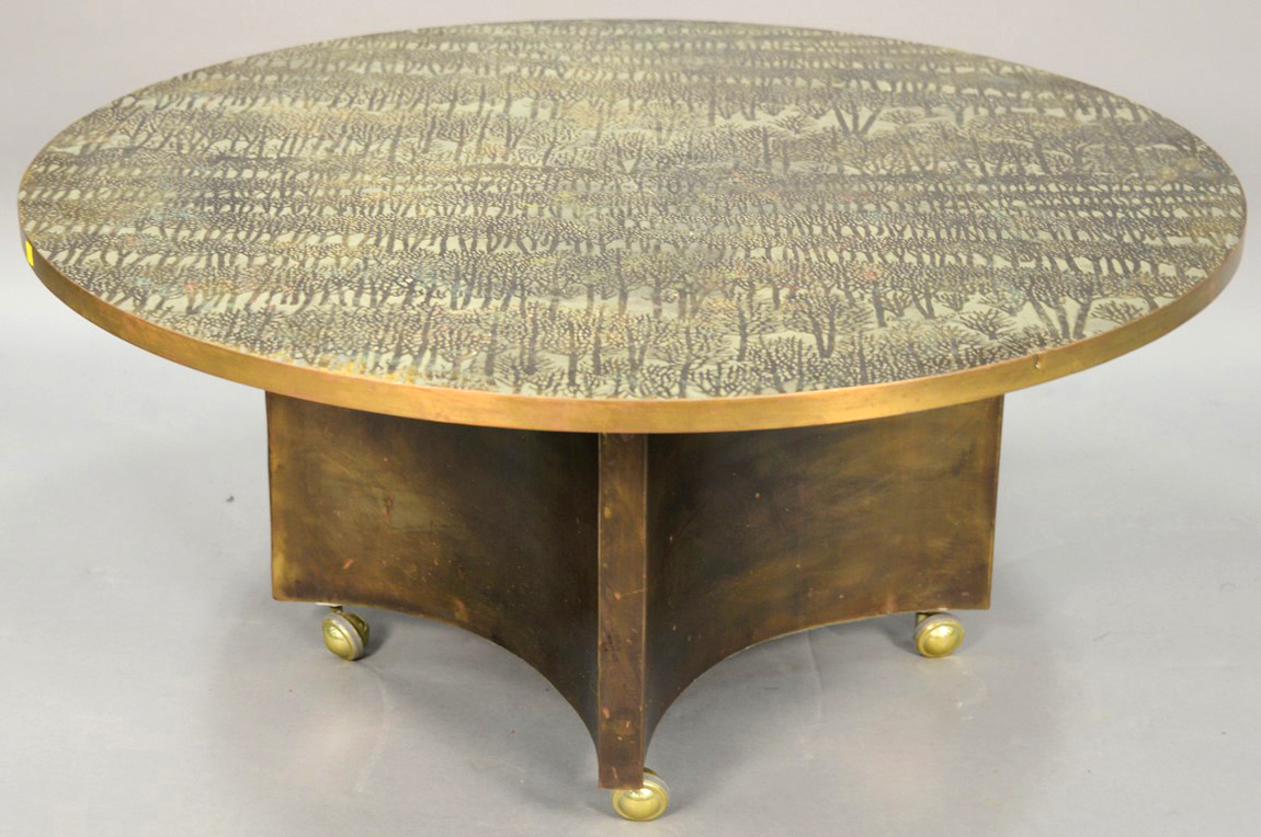 "This ""Eternal Forest"" coffee table, 41¾ inches in diameter with an acid-etched<br>and enameled brass surface, by Philip and Kelvin Laverne, doubled its high estimate, selling for $ 20,400 ($ 5/9,000). Two subsequent Laverne lots — a ""Chan"" coffee table of the same dimensions, $ 4,800, and a pair of ""Shang Ti""<br>end tables, $ 5,700 — also did well."