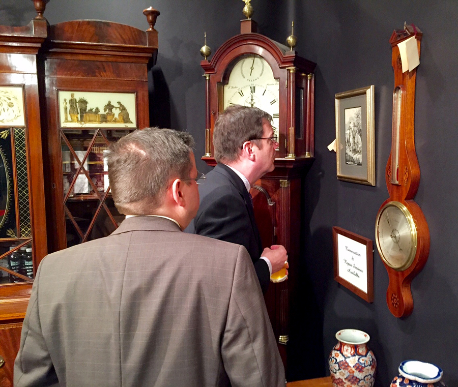 Checking out clocks and barometers at Gates Antiques Ltd., Midlothian, Va.