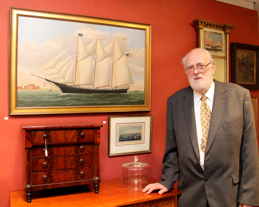 North Norwich, N.Y., dealer Jim Gallager with a miniature mahogany veneered chest of drawers and ship's portrait by the self-taught marine artist and antiques dealer Reginald Nickerson (1915–1999), who kept a shop in Yarmouthport, Mass.