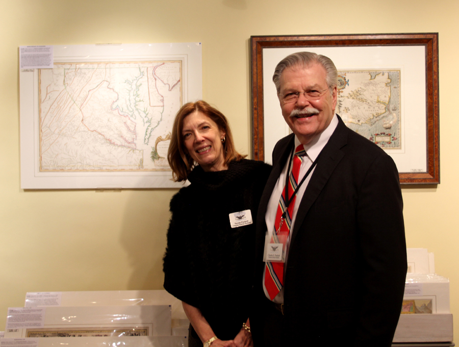Teresa and Charles Puckett, Akron, Ohio, with, left, a circa 1755 map of Virginia and Maryland by Joshua Fry and Peter Jefferson. Right is a circa 1606–34 map of the Midatlantic region by Hondius of Amsterdam.