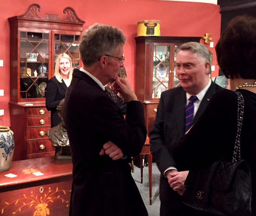 Virginia dealer Sumpter Priddy, left, greets patrons.