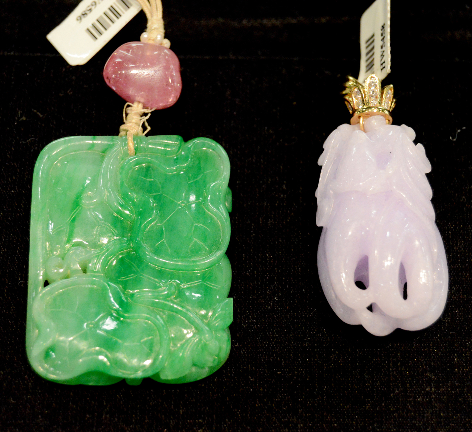 Hays Worthington, New York City, offered this antique green jade pendant<br>(shown at left) with tourmaline and a lavender jade citron pendant,<br>both Chinese and circa 1800s.