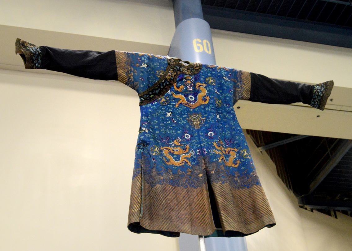 Hung way overhead at the booth of Haig's of Rochester, Rochester, Mich.,<br>was this Asian dragon robe.