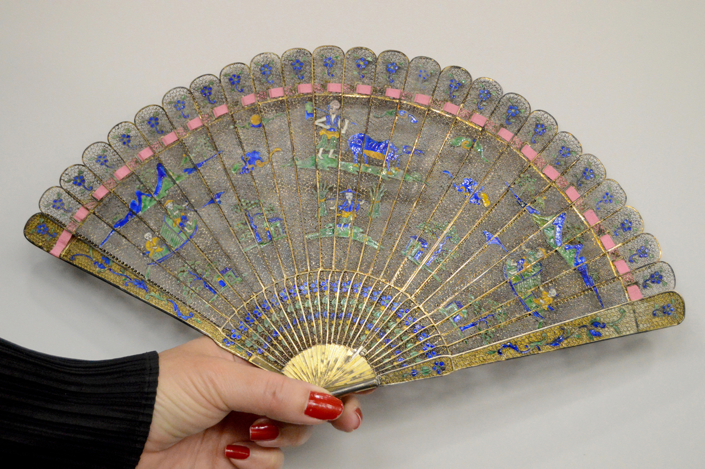 Dealer Cristina Ortega shows off an early Nineteenth Century filigree fan,<br>Chinese Export, at Sinapango, Paris