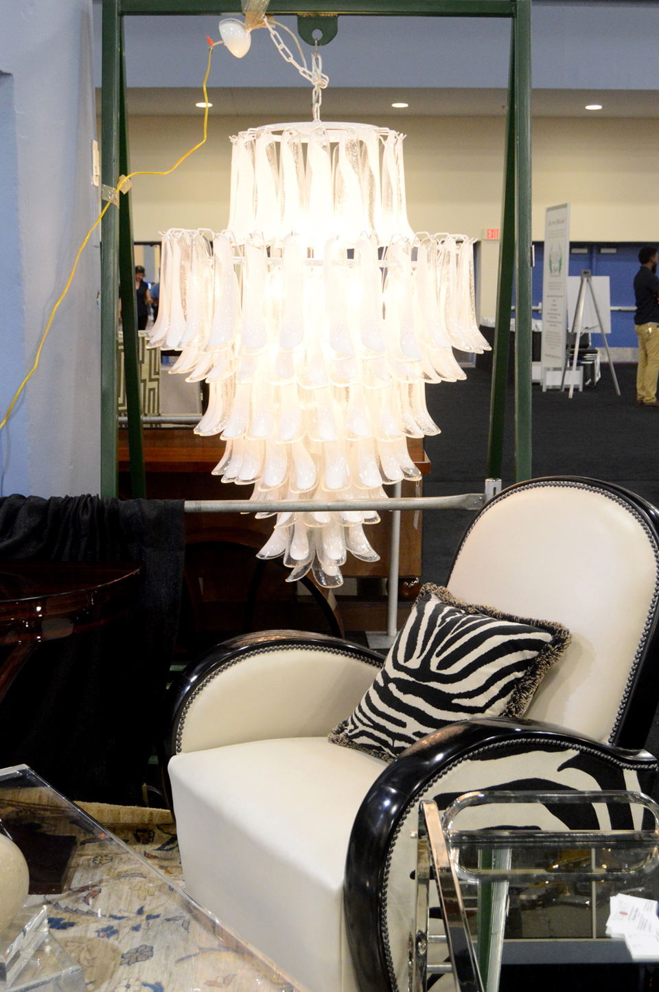 This Murano chandelier vied for attention with a pair of zebra club chairs<br>in the booth of Robert E. Alker Art Deco, Houston, Texas.