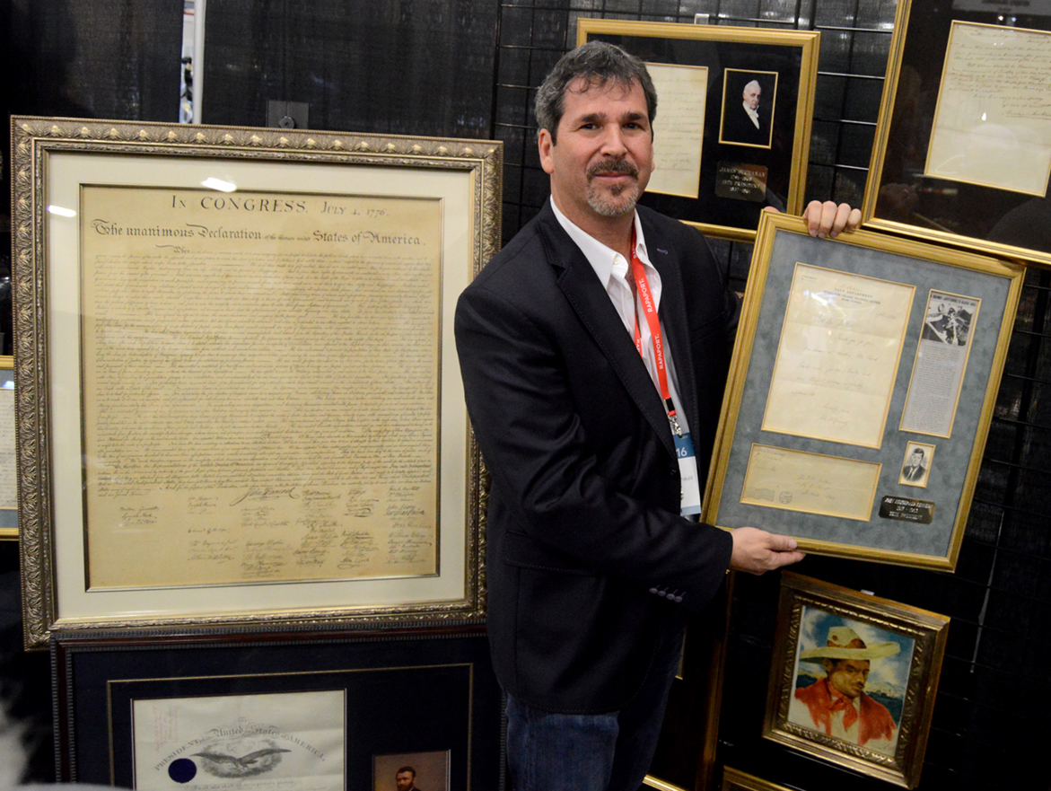 David Gindy, One Of A Kind Collectibles LLC, Coral Gables, Fla., shows off a copy of the Declaration of Independence he said John Quincy Adams commissioned and this letter from John F. Kennedy after the famed PT-109 boat incident.