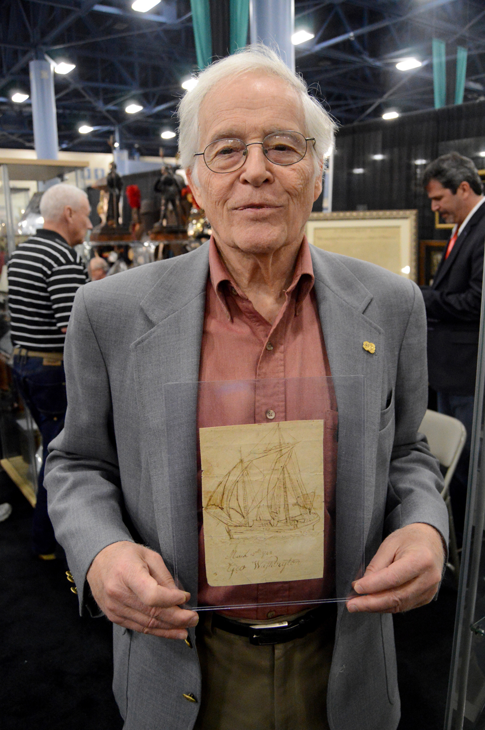 Tom Lingenfelter, Heritage Collectors Society, Doylestown, Penn., was offering<br>a drawing of a two-masted ship by a 10-year-old George Washington.
