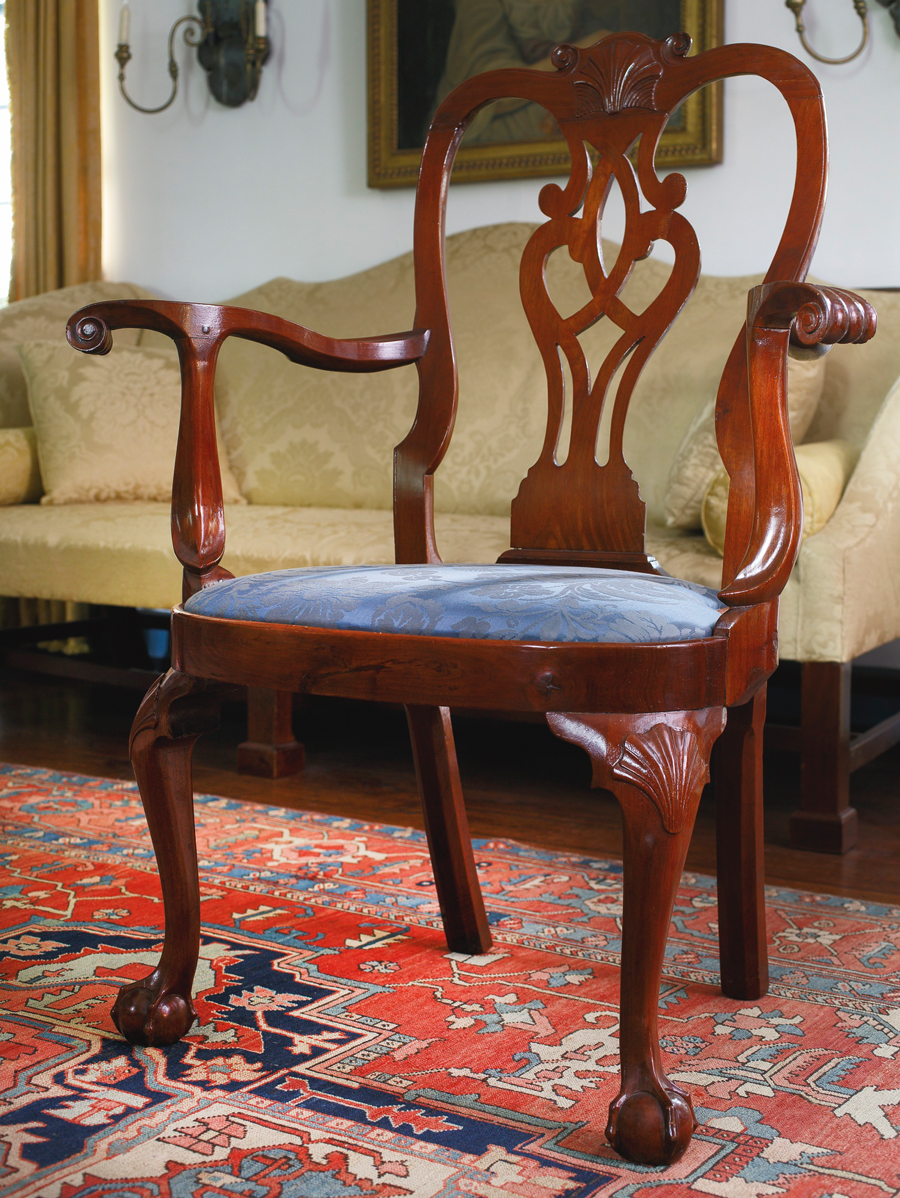 "Dealers and collectors in the room were often outbid by the phones on favorite items. One exception was this Philadelphia walnut compass-seat open armchair of circa 1755. It went to dealer H.L. Chalfant of West Chester Penn., for $ 100,000 ($ 60/120,000). Its mate is at the Metropolitan Museum of Art. The Met chair's replaced splat was copied from this original one. Chalfant described himself as a ""happy camper. I also got a bonnet-top highboy, spice boxes and a Wainscot chair I really wanted. I wish I'd had time to look at more."""