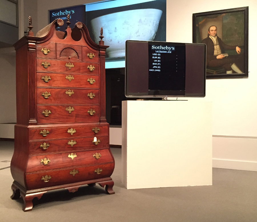 The top lot of the three-day auction was the circa 1770 North Shore, Mass., carved and figured mahogany bombe bonnet-top chest of drawers that descended in Burnham-Manning family of Ipswich, Mass. It went to a private collector by phone for $ 970,000 ($ 800,000–$ 1 million). Sotheby's sold the last example, of which only seven are known, in 2009 for a record $ 1,762,500. Portraits of Jared Lane, right, and a companion likeness of his wife, Apphia Ruggles, fetched $ 274,000 ($ 25/50,000). Ralph Earl painted the Litchfield County, Conn., couple in New Milford in 1796.