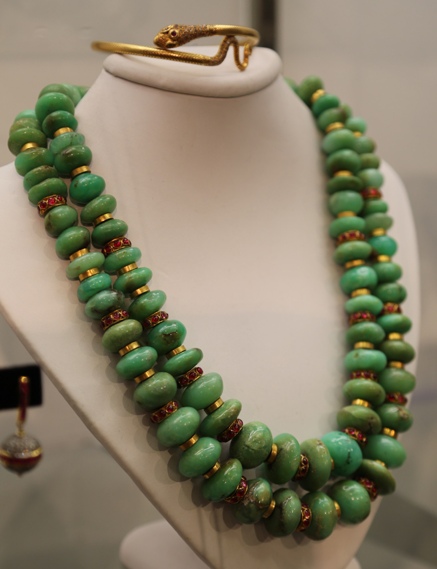 A chrysoprase necklace with gold rondels and inset rubies<br>was shown at Fair Trade Antiques, Shelburne Falls, Mass.