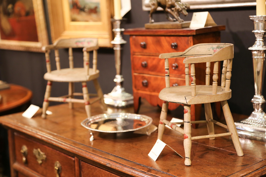 A pair of Nineteenth Century Sheraton doll chairs with original paint<br>at Donald Rich Antiques, New Canaan, Conn.