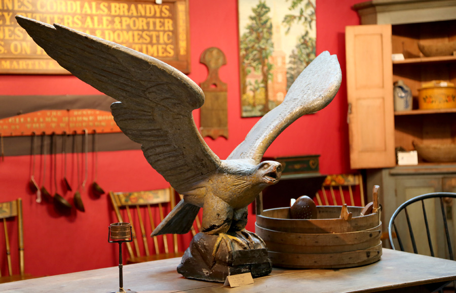 A pilot house eagle, circa 1850, welcomed visitors with open wings<br>in the Axtell Antiques booth from Deposit, N.Y.