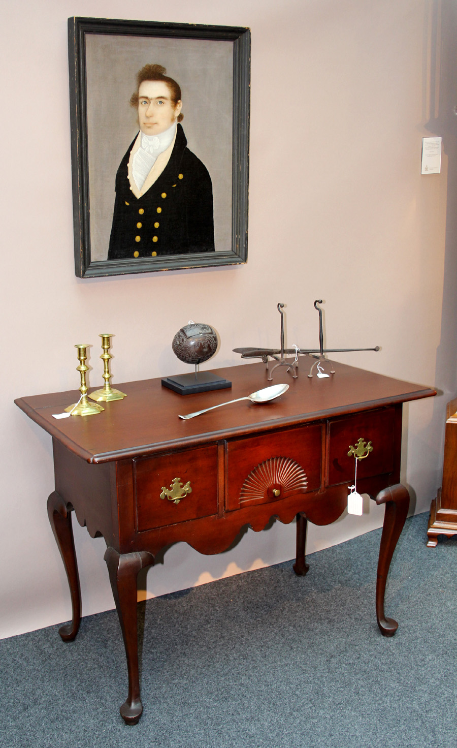 Big sales at Nathan Liverant and Son, Colchester, Conn., included the Connecticut Queen Anne cherry server with sunburst-carved center drawer and silver basting spoon by Joseph Copp, active in New London, Conn., between 1757 and 1776. Above is a portrait by Martha's Vineyard painter Frederick Mayhew.