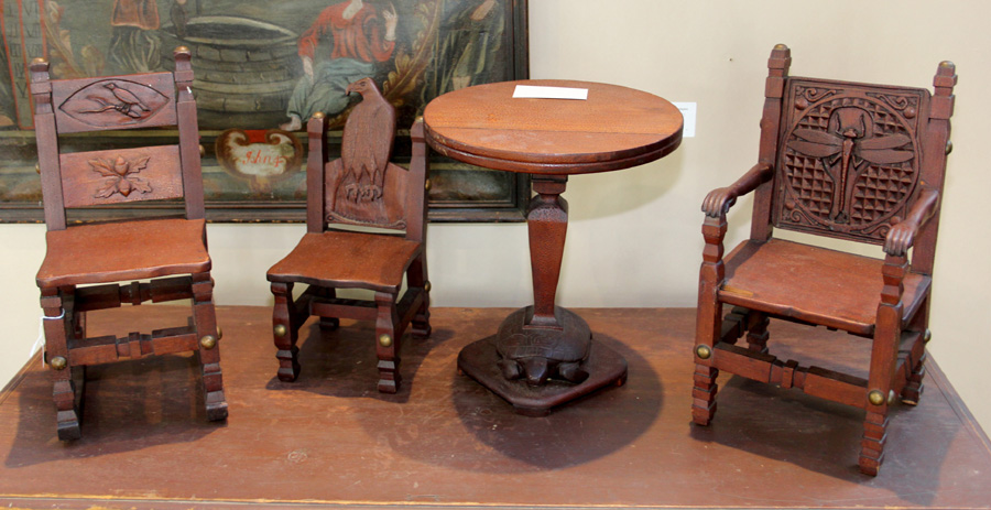 At Charles and Barbara Adams, South Yarmouth, Mass., this miniature table<br>and three chairs was signed by their New Haven, Conn., maker.