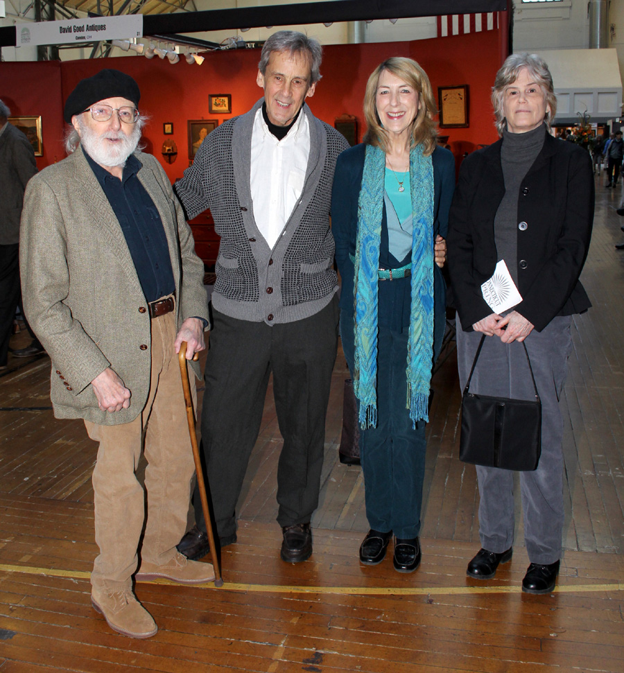 Far left and right, Dave Hewett, longtime chronicler of the<br>Connecticut Spring Antiques Show, and his wife, Janna,<br>visited with auctioneers Will and Karel Henry, center.