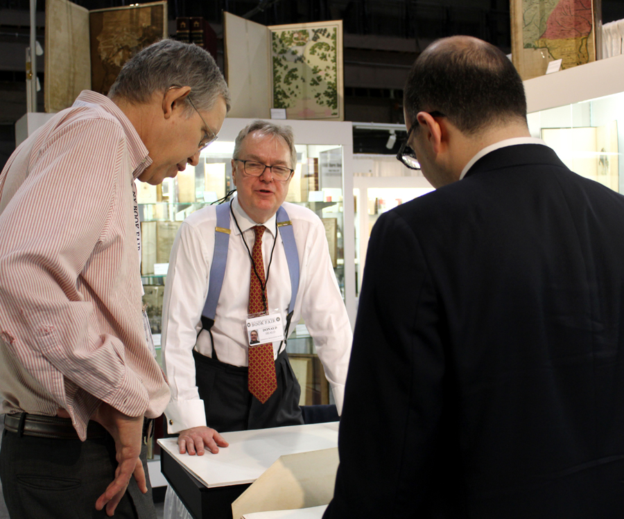 From left, dealers Bill Reese, Donald Heald and Jeremy Markowitz examine a newly arrived portfolio of Eadweard Muybridge stop-action photographic prints.