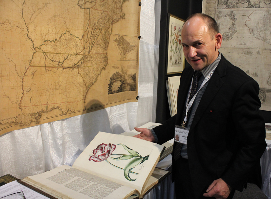 Robert Berg of Antiquariat Reinhold Berg, Regensburg, Germany,<br>with a rare bound collection of botanical prints.