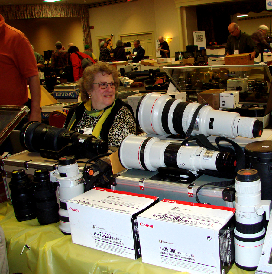 Joe and Karen Lippincott brought Nikon and Canon telephoto lenses for<br>serious photographers. The Nikon 500mm lens was priced at $ 3,650<br>and a Canon 500mm was stickered $ 975.