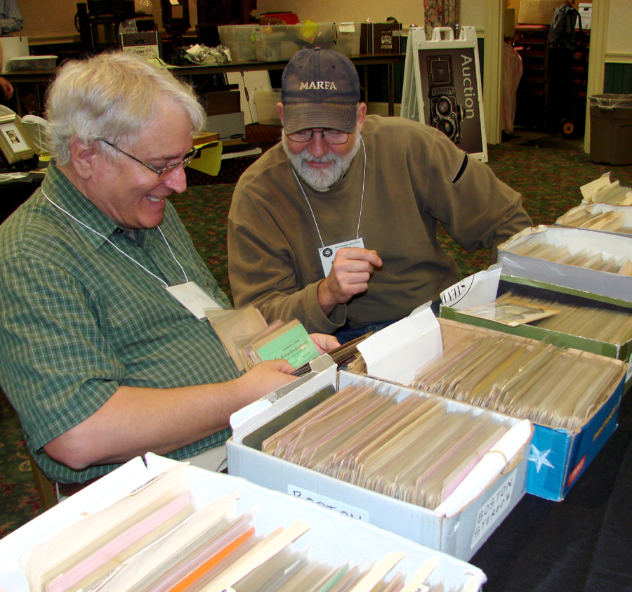 Keith Brady and Fred Sherey, stereo collectors from Harrisburg, Penn.,<br>look through the views offered by Greg French.