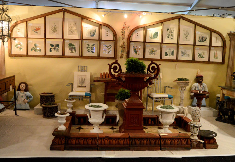A terra cotta garden surround, Trenton, N.J., and a large pair of<br>late Nineteenth Century, wooden window frames (shown on wall)<br>were highlights at Firehouse Antiques, Galena, Md.
