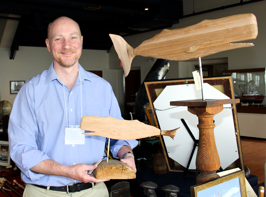 Wooden whirligigs are a sideline for Parke Madden,<br>who carves and sells the figures in his Cape Cod shop.
