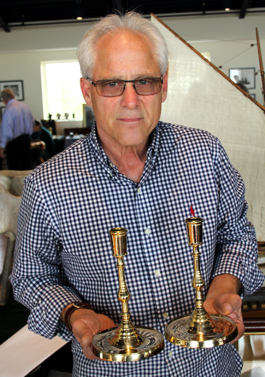 Brad Finch of Spyglass Antiques in Brewster, Mass.,<br>offered this pair of Flemish brass candlesticks of about 1650.