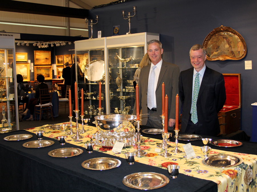 Mark McHugh and Spencer Gordon of Spencer Marks Ltd. set their table with a Kalo Shop presentation service for 12 and a circa 1950 Allan Adler and Porter Blanchard hand-wrought punch service. Above right, an 1889 Gorham silver and mixed metals fancy waiter custom ordered by Jesse H. Metcalf, co-owner of the yacht Sachem, designed by Edward Bu8rgess and built by Lawley & Son.