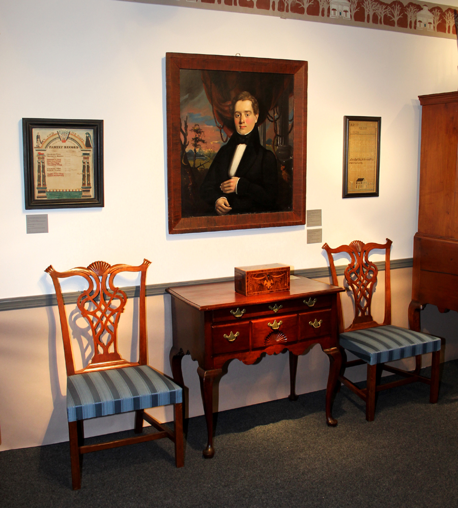 Liverant Antiques sold the pair of Eliphalet Chapin, East Windsor, Conn.,<br>cherry side chairs. The cherry dressing table is attributed to the Willard Group<br>of Wethersfield, Conn., 1770-90. Above, the oil on canvas portrait of<br>Elliot F. Clark of Maine is attributed to William M. Prior, 1835-40.