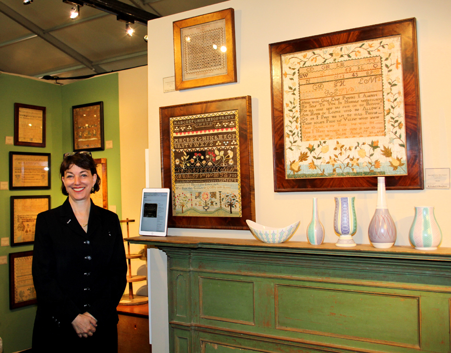 Philadelphia dealer Amy Finkel sold the two major pieces above her mantel. Below left, a fully worked sampler by Hepsy Neal of Stratham, N.H. by, circa 1790. Right, a Salem, Mass., sampler by Peggy Silver, dated 1797.