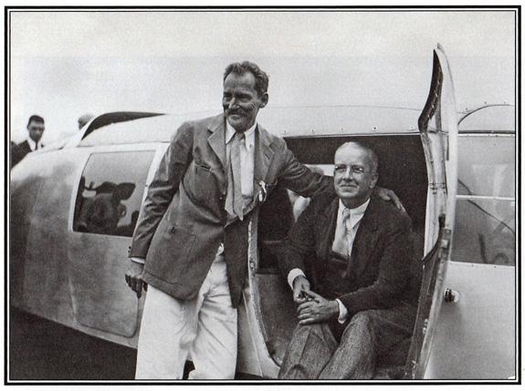 "R. Buckminster ""Bucky"" Fuller (1895–1983) and W. Starling Burgess (1878–1947) sitting in Dymaxion car on July 21, 1933."