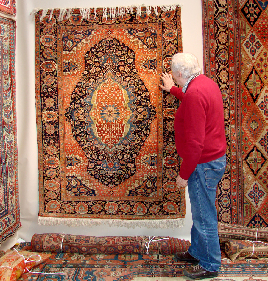 Wiscet Maine Antiques Dealer Michael Dunn Looks At A Rug In Doug Stock S Booth