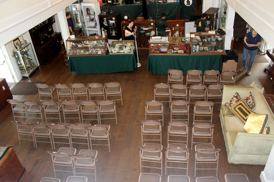 In nearly military-style precision, the central area of the hall is cleared by the firm's staffers at 11:30 am, and chairs set up to accommodate patrons for the auction beginning at noon.