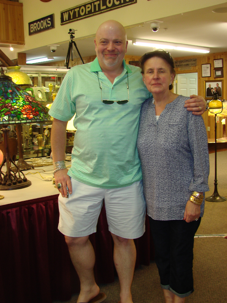 A surprise attendee at a glass and jewelry auction was Butch Berdan, a Newcastle, Maine, dealer. He is shown with Kathe Jewett, his partner's mother, who came to buy jewelry, which she did.