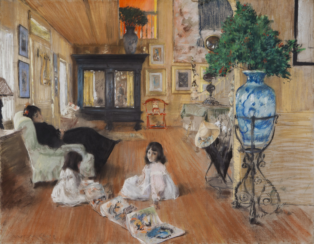 "In 1891, Chase established a studio in Shinnecock, Long Island, N.Y., and founded a summer art school there. This scene of his family poring over a portfolio of Japanese prints shows how work and play intertwined for the artist. ""Hall at Shinnecock,"" 1892. Pastel on canvas. Terra Foundation for American Art, Daniel J. Terra Collection."