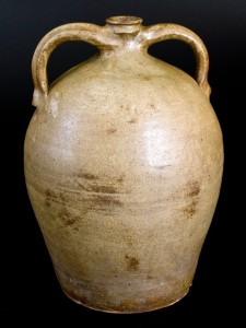 """Alkaline-glazed double-handled stoneware jug, incised """"Dave"""" and impressed """"C,"""" Dave at the John or Abner Landrum Potteries, Horse Creek Valley or Pottersville, Edgefield District, S.C., circa 1825–35, $46,000 ($10/$20,000). This may be the earliest signed """"Dave"""" vessel and the only one with double handles."""