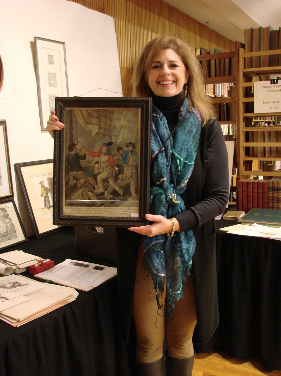 Ann and Richard Thorner, Manchester, N.H., deal in historical prints and ephemera. Ann is holding an important print, published in London in 1779, depicting John Paul Jones shooting a sailor. They had bought it at Northeast Auctions earlier in the week and priced it here at $9,850. —Boston Book, Print and Ephemera Show
