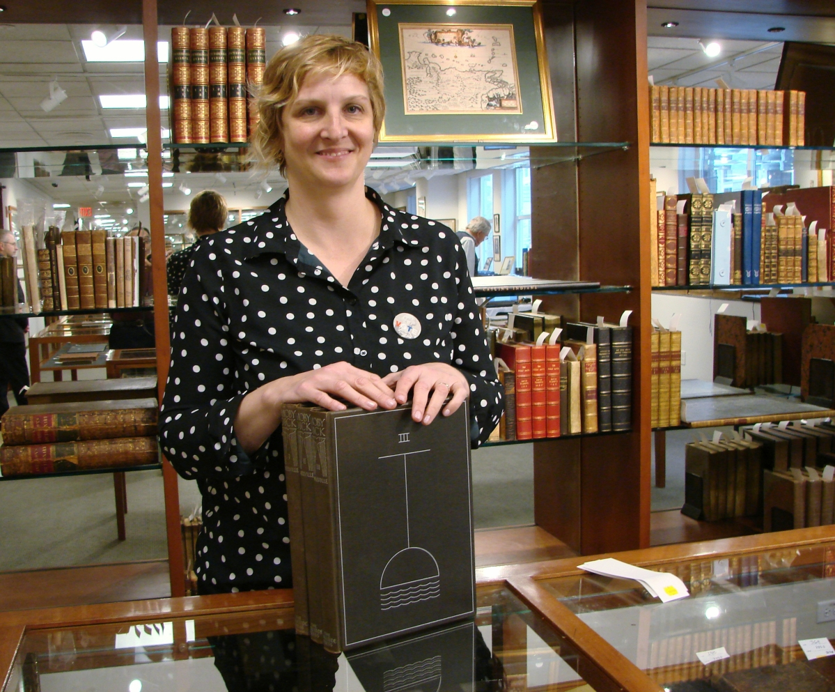 Devon Eastland, director of Skinner's rare books and manuscripts department, with her favorite set of books in the sale, a three-volume set of Herman Melville's Moby Dick, illustrated by Rockwell Kent.     —Skinner