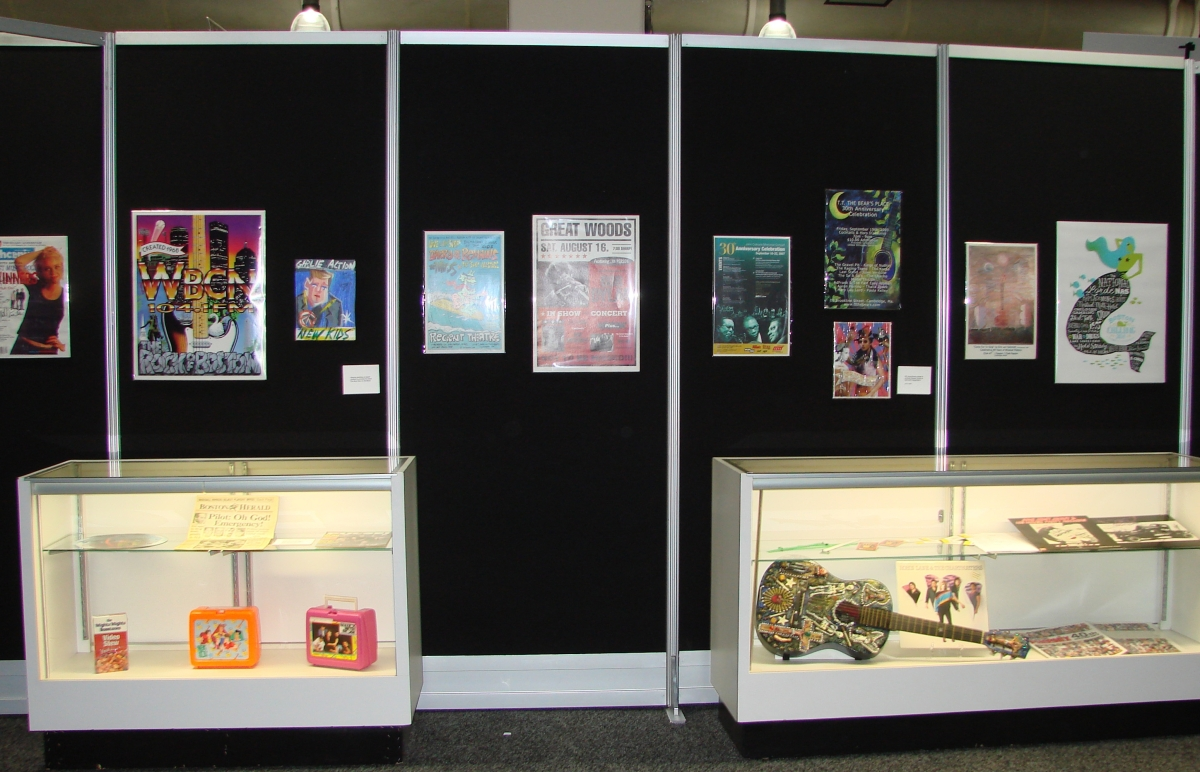 """The Boston International Antiquarian Book Fair's special exhibition, """"Collecting The Boston Music Scene,"""" displayed a portion of the collection of David Bieber, formerly of radio station WBCN. It displayed concert posters, record albums and ephemera covering over 40 years of music history in Boston."""