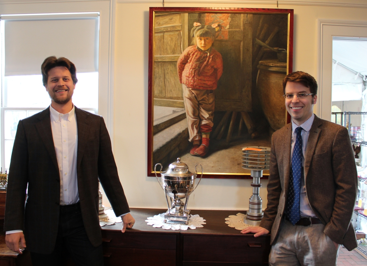 Butterscotch Auction Gallery's sale administrator Alex Fonarow, left, and Brendan Ryan, appraiser and auctioneer, with the top-selling work by Chinese contemporary artist Xu Yangzhou, one of five works by the artist offered in the sale.