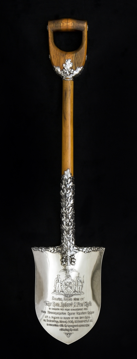 Mayor Robert Van Wyck wielded this ornamental tool at the groundbreaking ceremony for the city's first subway. Ceremonial shovel made by Tiffany & Co., 1900. Sterling silver and wood.