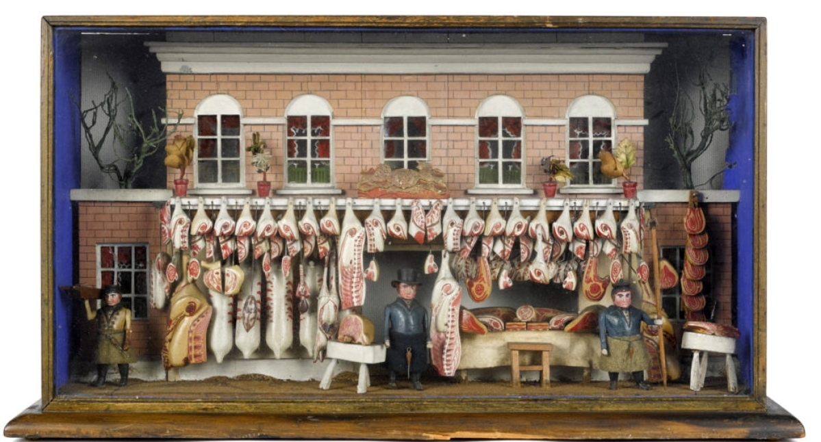 A phone bidder, represented by the last lady standing, was the winner of the top lot in the auction, an elaborate English butcher shop diorama window display dating from the mid-Nineteenth Century. Primarily of painted wood and embossed paper board, this example shows 75 various cuts of meat and carcasses of meat tended to by two sturdy butchers and a delivery boy, the façade with glazed window, potted plants and a lion and unicorn crest. It measures 13 inches high, 23 inches wide and 6 inches deep, carried a high estimate of $6,000, and sold for $33,600.