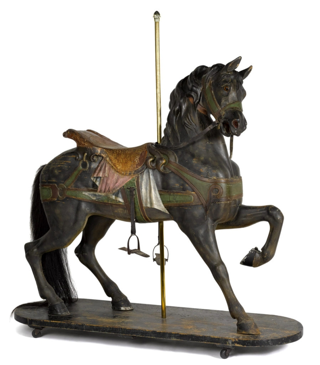 "Standing at the entrance to the gallery and greeting visitors was this Gustav Dentzel carved and painted outside row standard carousel horse, circa 1905, in the original polychrome decorated surface with an eagle backed saddle, often referred to as a ""sweet-faced"" horse, 57 inches high. Carrying a high estimate of $12,000, it realized $20,400."