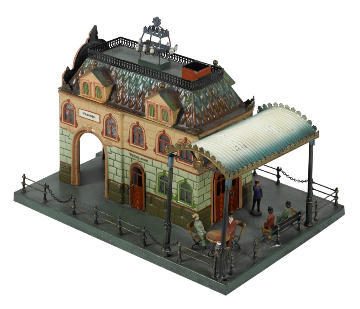 Selling at the high estimate, $18,000, was this Marklin Central-Bahnhof Train Station, no. 2651, hand painted with candlelit interior with tables, chairs and benches. It has etched and stained glass windows and features an outdoor café under an arched canopy. It was last sold on May 21, 2011, at a Noel Barrett auction.
