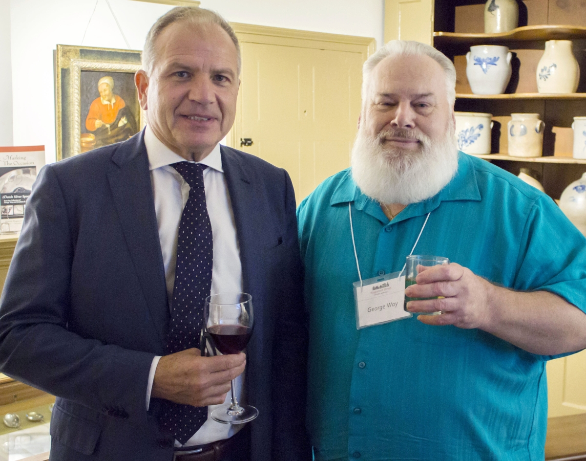 George Way, right, stands with the recently appointed consul general of the Kingdom of the Netherlands, the Honorable Dolf Hogewoning, who visited the exhibit at Historic Huguenot Street in October.